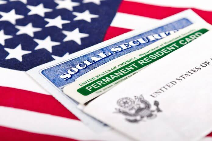 green card on a us flag