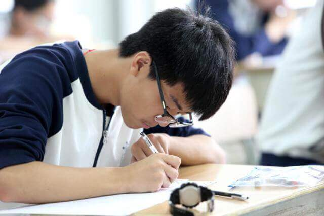 five arrested for english exam cheating