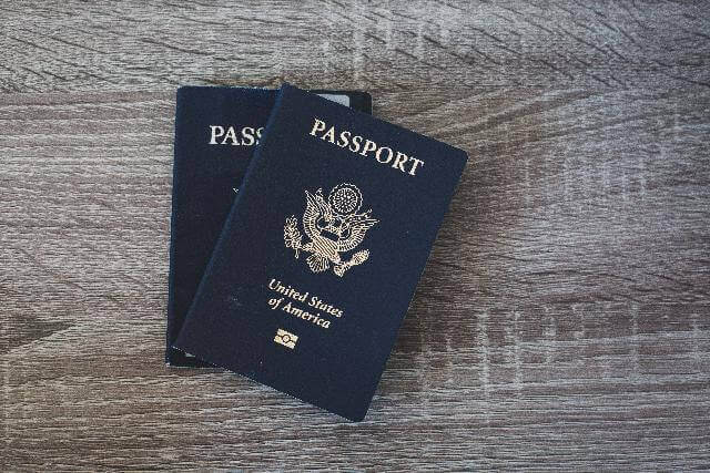 two us passports on a table