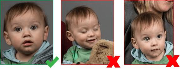 toddler taking a photo for australian visa